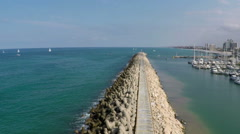Aerial view of a Big concrete pier in Herzliya marina, Israel Stock Footage