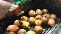 A chef is greasing yellow beetroots, with butter, before smoking them, at a rest Stock Footage