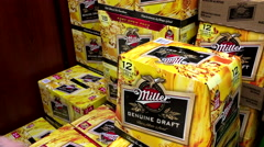 Shoppers buying Miller beer. Top news of Miller brand been sold to Budweiser. Stock Footage