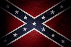 Closeup of textured Confederate flag - stock photo