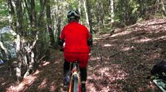 Ride a bike over mountain terrain race track Stock Footage