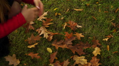Woman gathering autumn fall leaves 4K. Stock Footage