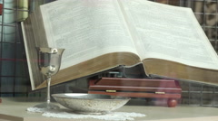 the holy bible in a store window  - stock footage