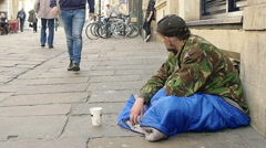 Homeless receive charity in the street  Stock Footage