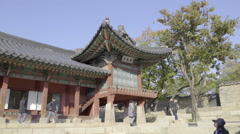 Some tourists looking around at Chandeokgung Palace in South Korea Stock Footage