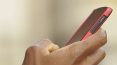 Black businessman using smartphone: closeup footage on his hand  Stock Footage