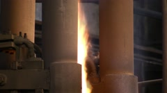 Fire and smoke from electric arc furnace. - stock footage