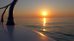 Gunwale POV - Floating on the water at sunset Stock Footage