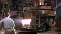 Worker operates in blast furnace workshop of metallurgical plant Stock Footage