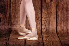 Fourth position in classical ballet. Ballet pas. Legs of ballerinas. - stock photo
