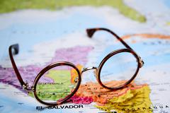 Glasses on a map - Guatemala Stock Photos