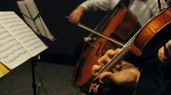 Violin and cello hand playing wide Stock Footage