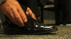 Tying shoe lace low shot - stock footage