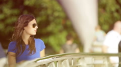 sad woman on the bridge: young woman staring into space  - stock footage