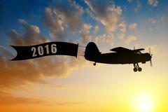 Engine airplane flying at sunset. Stock Photos