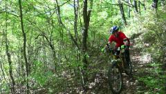 Mountain biking on Forest Race Trail single-track Stock Footage