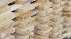 Planks of wood stacked neatly on the shelves in the hardware store. Stock Footage
