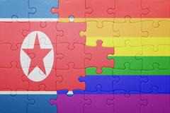 puzzle with the national flag of north korea and gay flag - stock photo
