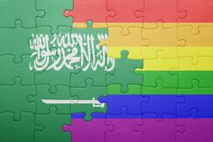 puzzle with the national flag of saudi arabia and gay flag - stock photo