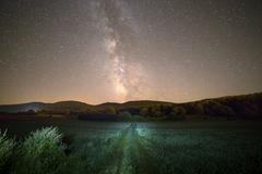 Milky way and green way Stock Photos