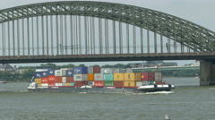 4K UHD POV Skyline Cologne Köln Container Cargo Barge passing Hohenzollern Stock Footage