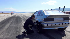 Drag race custom mussle power car start on track. Tires check up Stock Footage