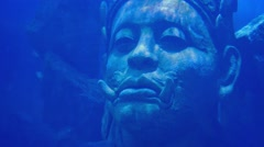 Head Of Ancient Diety Statue Underwater Stock Footage