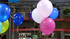 Helium balloons hang from the ceiling in the cafe celebration birthday Arkistovideo