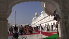 Stock Video Footage of Sikh pilgrims in  Golden Temple  in Amritsar, Punjab, India.