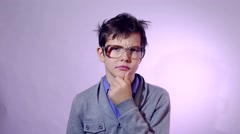 Teenager shaggy boy glasses nerd portrait he raised his finger up idea schoolboy Stock Footage