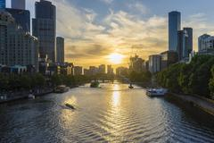 Downtown Melbourne across the Yarra river at sunset - stock photo