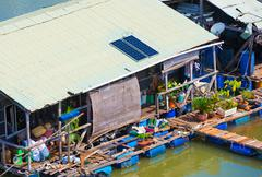 Water dwelling house at fish breeding farm in Vietnam Stock Photos