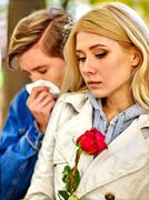 People with a cold blowing nose  handkerchief fall outdoor Stock Photos