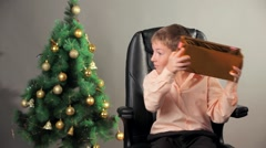 Happy Boy Unpacking Present Box On Christmas Stock Footage