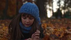 Girl is swinging on leaves Stock Footage