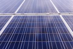 Close up of solar cells for renewable solar energy with the sun. Stock Photos