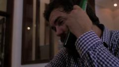 A young man with a full beard orders a beer and cools himself off with it Stock Footage