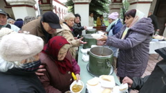 Church personnel is giving Food for the poor Stock Footage