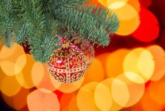 Christmas ball hanging on evergreen tree Stock Photos