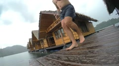 Young Man Jumping into Lake Water. Khao Sok. Thailand Stock Footage