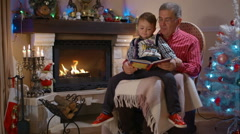 Grandfather and grandson reading a book Arkistovideo