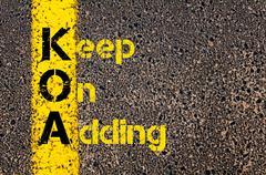 Business Acronym KOA as Keep On Adding Stock Photos