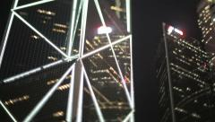 Panning shot of skyscrapers in Hong Kong at night, filmed with tilt shift lens - stock footage