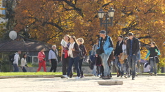 Crowd tourists group sightseeing tour with guid in city center of Sofia Bulgaria Stock Footage