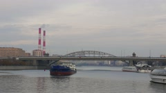 View on Moskva River, Berejkovskiy Bridge and ship above whem, establishing shot Stock Footage