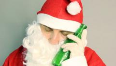 Drunken santa claus sleeping with beer in hand Stock Footage
