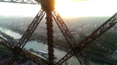 Wonderful view of Paris from moving Eiffel Tower lift in sunrise or sunset light Stock Footage