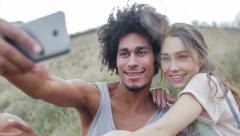 Young, athletic, attractive mixed race couple relaxing in nature Stock Footage