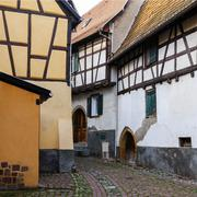 Stock Photo of Half-timbered houses on a narrow street in Eguisheim, Alsace, France