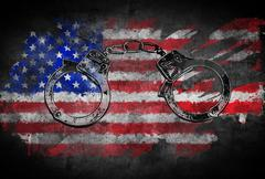 Handcuffs and flag of United States - stock illustration